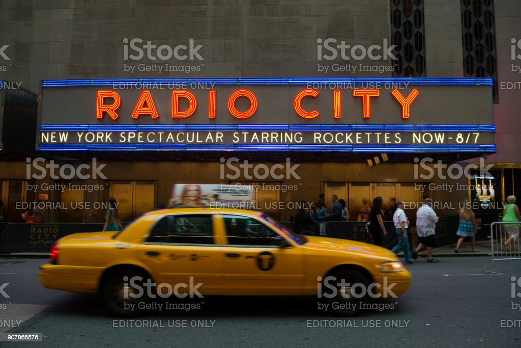 Radio City Music Hall and New York City taxi stock photo