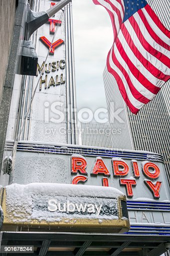 New York City, NY, USA - February 08, 2017: Close up shot of Radio City sign covered with snow and ice, in New York City
