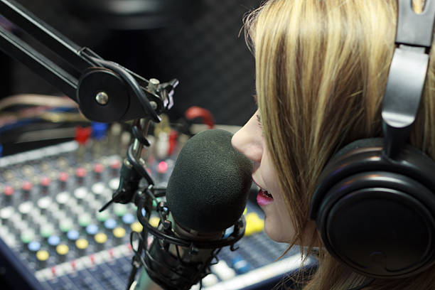 Radio DJ Beautiful Woman Working As Radio DJ Live In Studio radio dj stock pictures, royalty-free photos & images