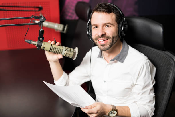 radio host moderating at on air talk show - trasmissione radiofonica foto e immagini stock