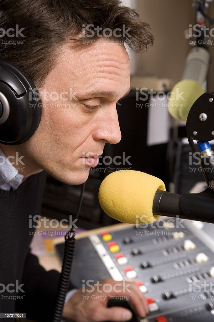 Radio host with microphone. royalty-free stock photo