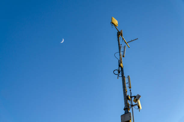 Radio Mast and the Moon stock photo