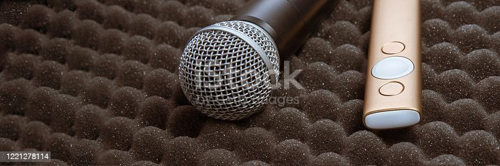 854811490 istock photo radio microphone Item stand on foam grey rubber 1221278114