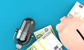 istock Radio microphone with piggy bank and euro currency 1263653074