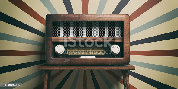 istock Radio old fashioned on wooden table, retro wall background, 3d illustration 1128693152