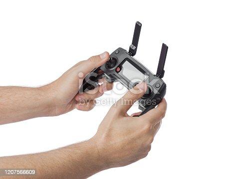 istock Radio remote control in hands 1207566609