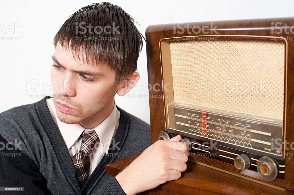Radio Show.  A young man with antique radio. stock photo