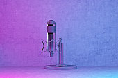 istock radio station microphone in pink-blue lighting 1218856881