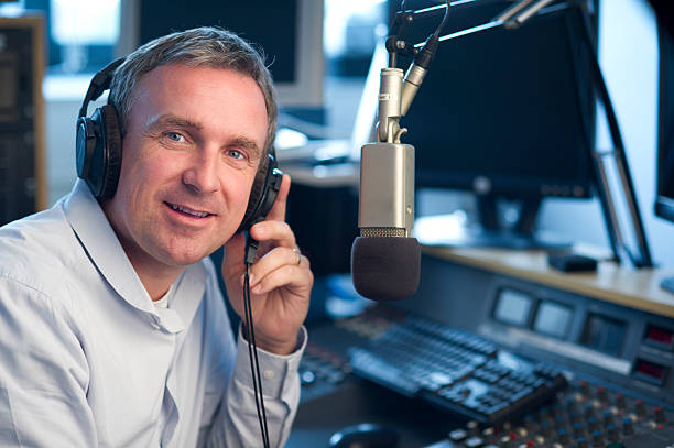 radio station presenter dj looks to camera radio dj stock pictures, royalty-free photos & images