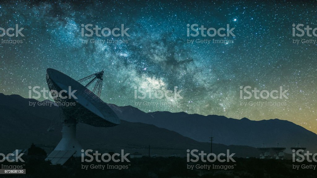 Radio telescope against rising Milky Way stock photo