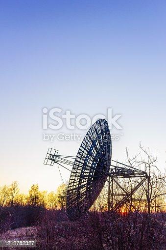 radio telescope dish satellite equipment at sunset landscape observatory