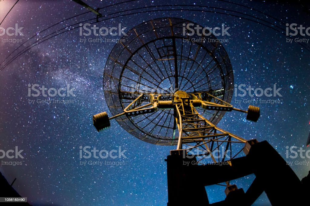Radio telescopes and the Milky Way at night stock photo