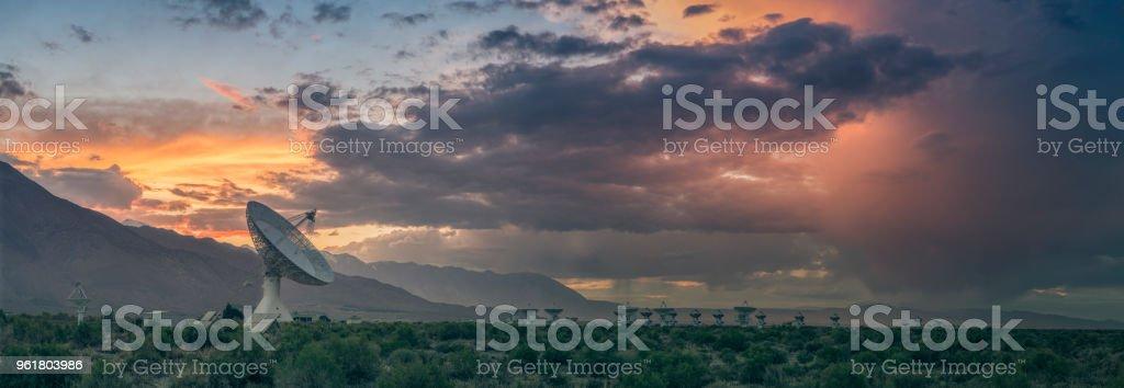 Radio telescopes in remote location at sunset stock photo