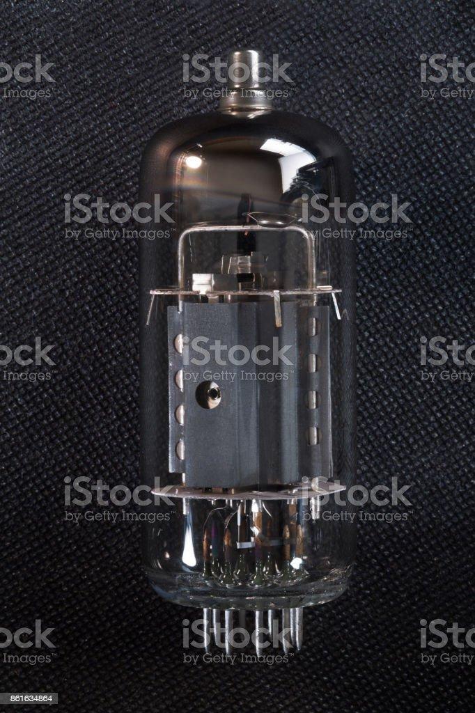 Radio tube on gray background stock photo