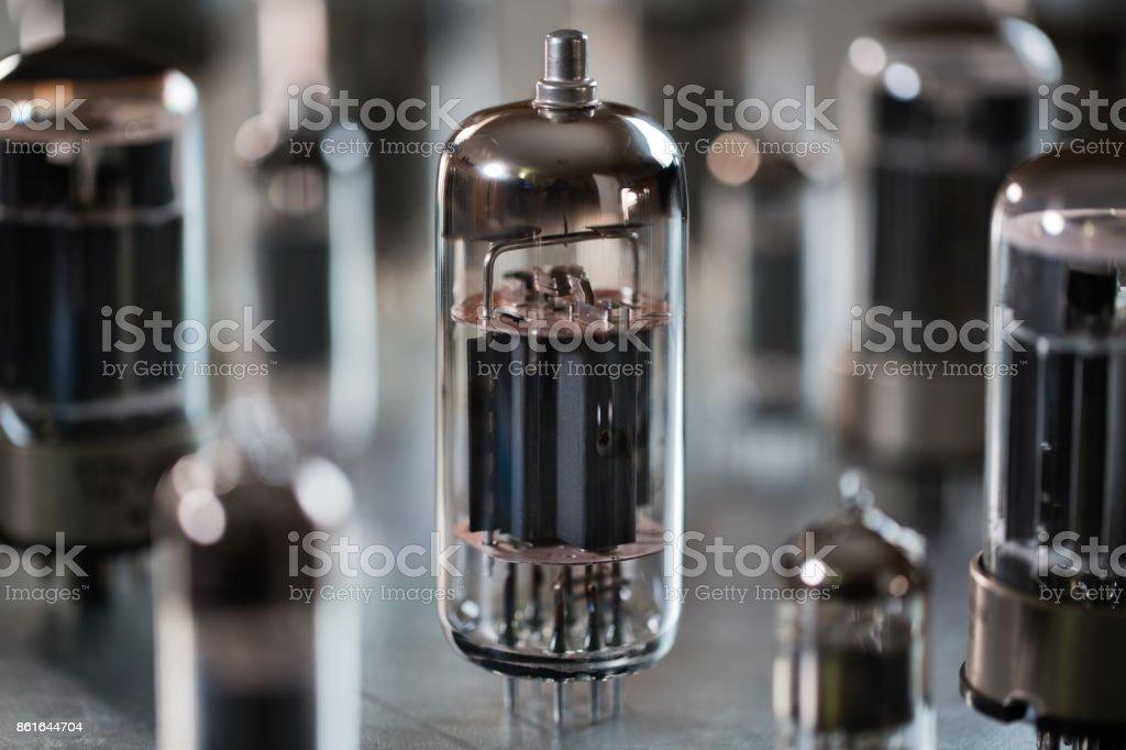 Radio tubes on a metal surface stock photo