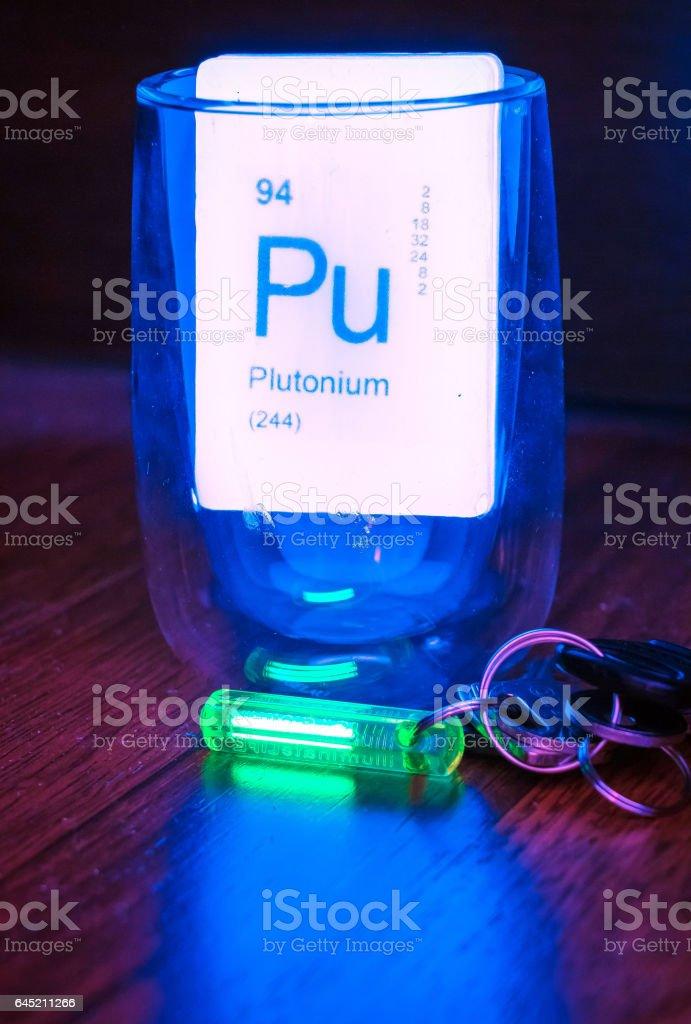 Radioactive joke soap and green glowing trinket with radioactive tritium stock photo