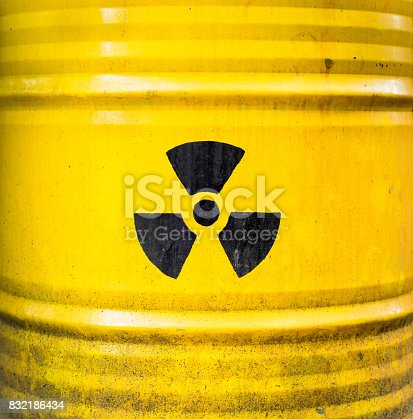 istock Radioactive sign, icon and symbol on yellow nuclear waste barrel. 832186434