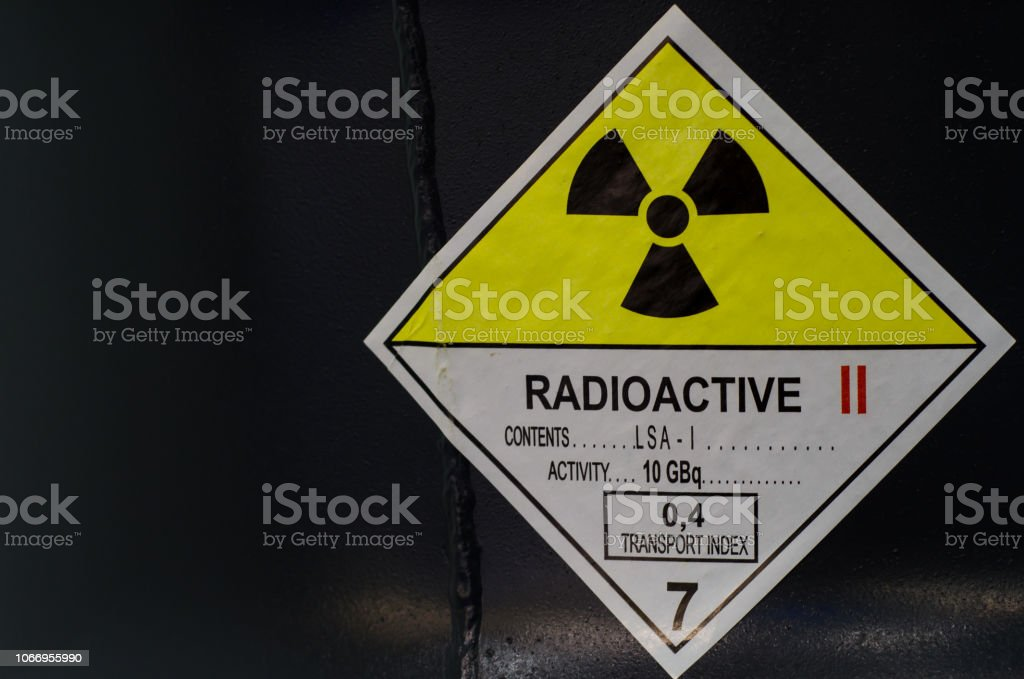 Radioactive sign on barrel. stock photo