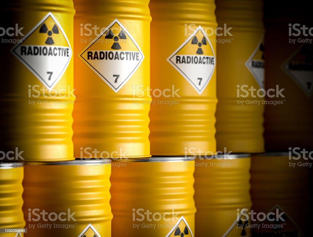 radioactive yellow barrel stock photo