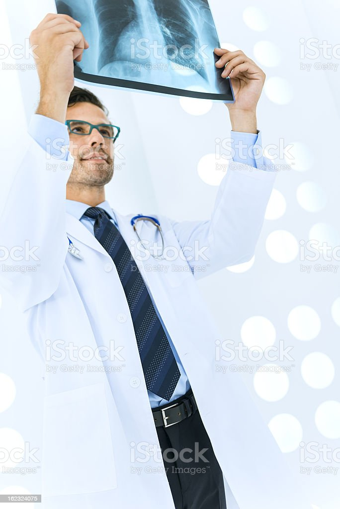 Radiologist checking X-Ray of lungs royalty-free stock photo