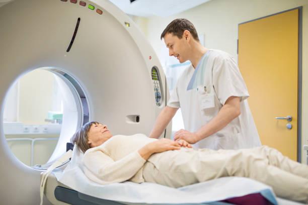 Radiologist consoling senior female patient stock photo