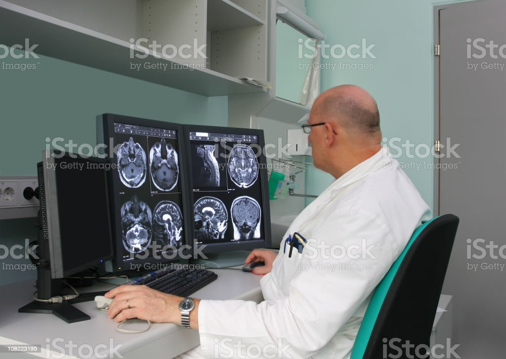 Radiologist is examing MRI scans royalty-free stock photo