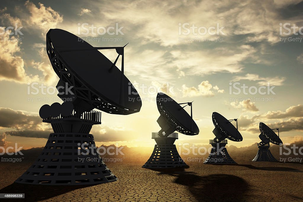 Radiotelescopes silouette at sunset stock photo