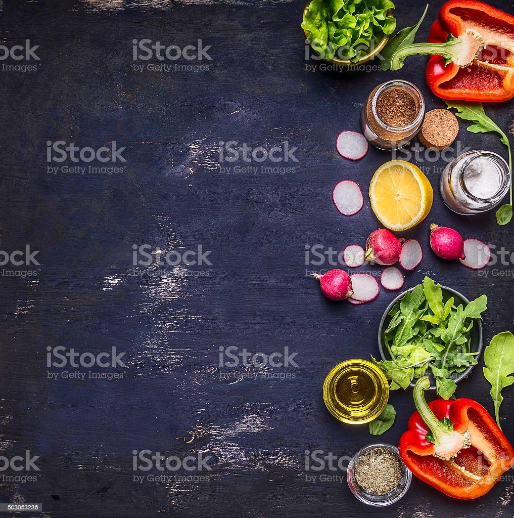 radish lemon arugula lettuce salt seasoning wooden background top view stock photo