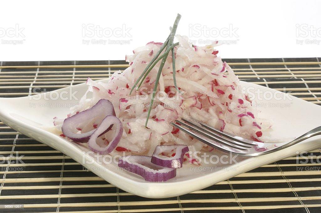 Radish salad with onion rings royalty-free stock photo