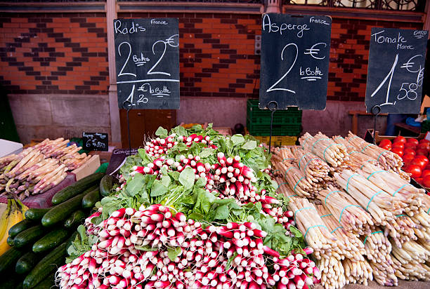 Radishes and asparagus in Les Halles Market, Dijon, France stock photo