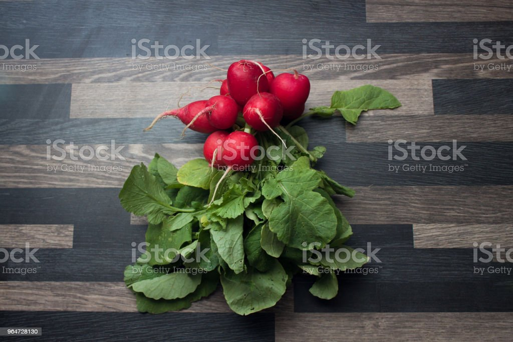 Radishes on a gray kitchen counter top royalty-free stock photo