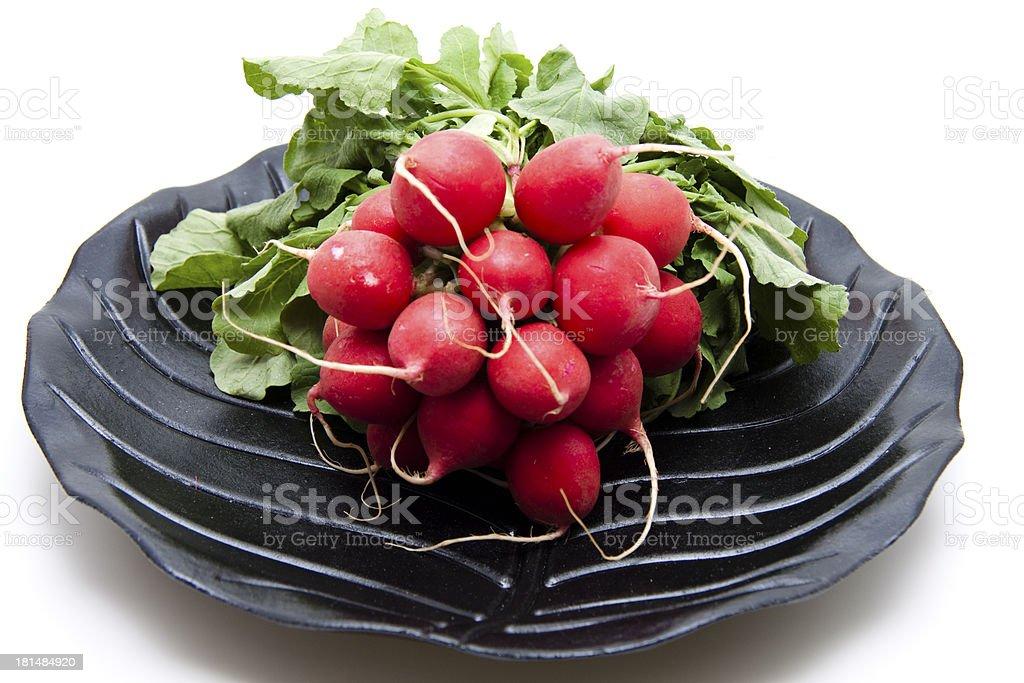 Radishes on black plate stock photo