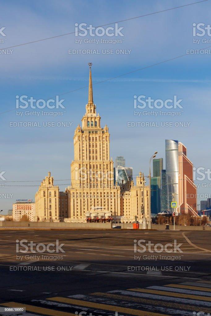 Radisson Royal Hotel (Hotel Ukraina) against blue sky in spring morning stock photo