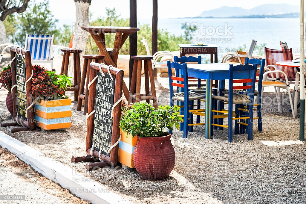 raditional Greek taverna, decorated with menu on wooden plate stock photo