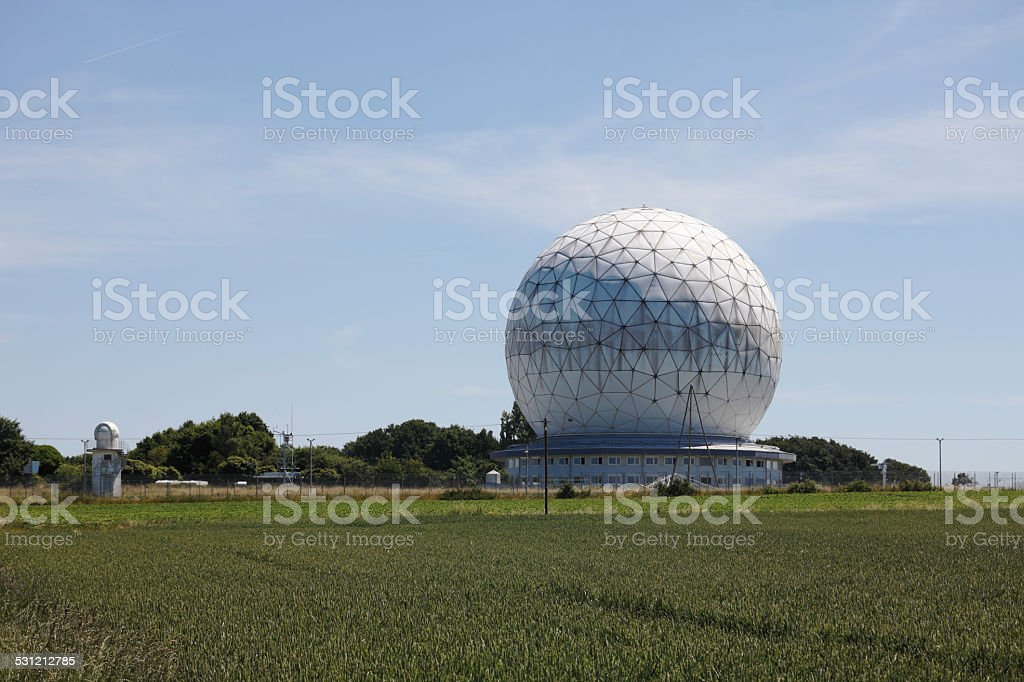 Radome with field in foreground. stock photo