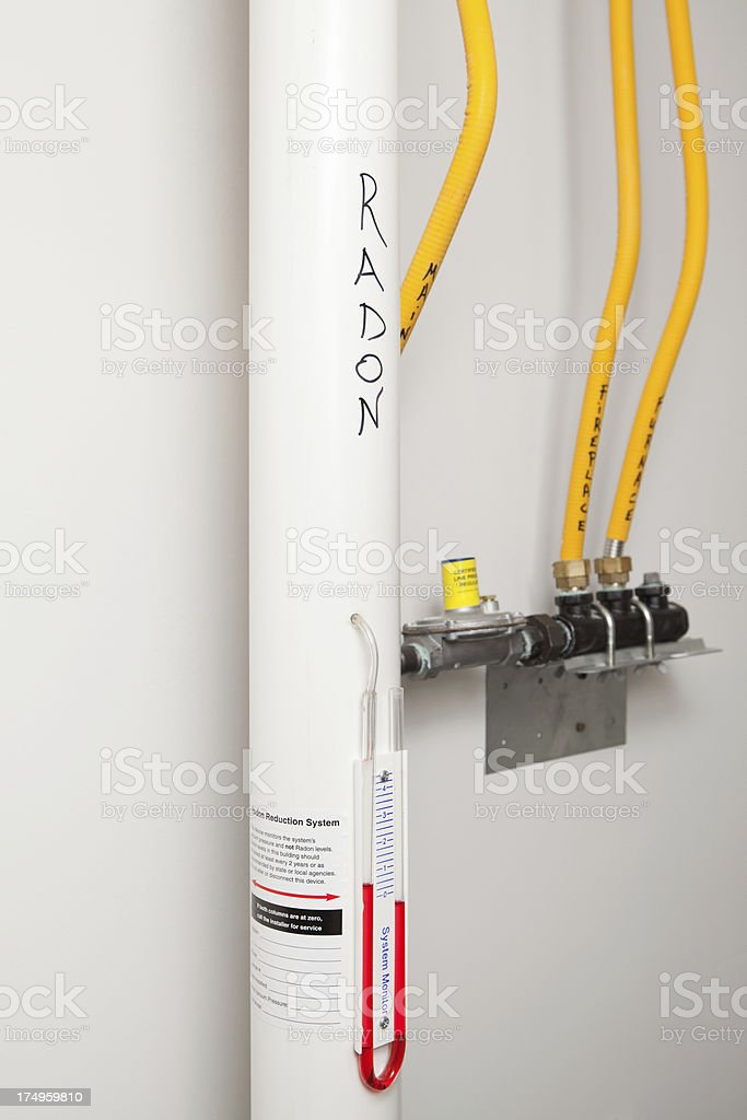 Fan Monitoring System : Radon vent fan pipe and monitoring system stock photo