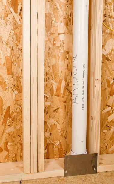 pvc radon vent tube in new home construction project - radon test stockfoto's en -beelden