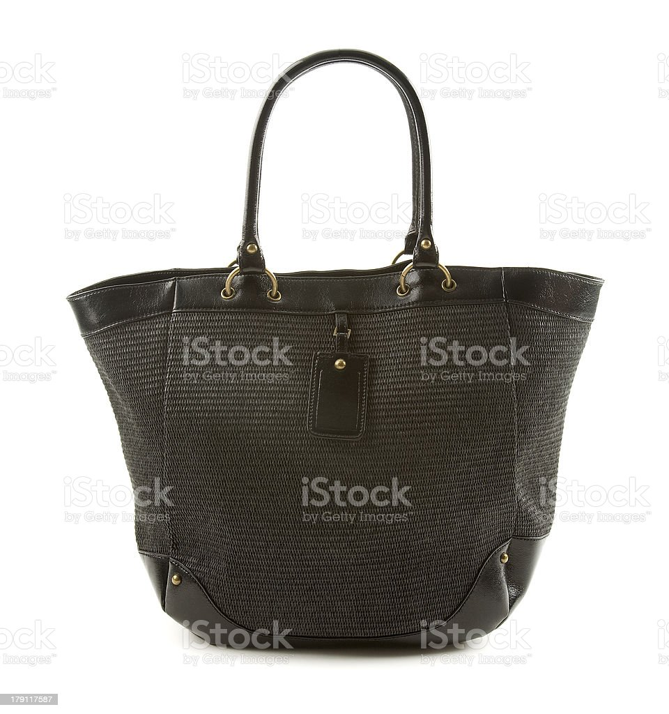 Raffia and black leather basket tote stock photo