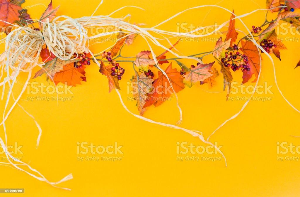 Rafia And Fall Leaves Garland stock photo