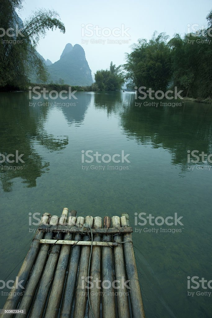Raft on  river with Karst mountain landscape in Guilin stock photo