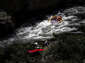 A rafting boat goes progresses through the River.