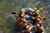 rafting boat  extreme sports colors people rowing in Arahthos river Arta - Ioannina  Greece