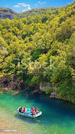istock rafting boats and athletes in  river Voidomatis just before begin the voyage in greece 1163647306