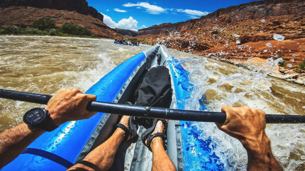 POV  rafting with kayak in Colorado river, Moab POV  rafting with kayak in Colorado river, Moab colorado river stock pictures, royalty-free photos & images