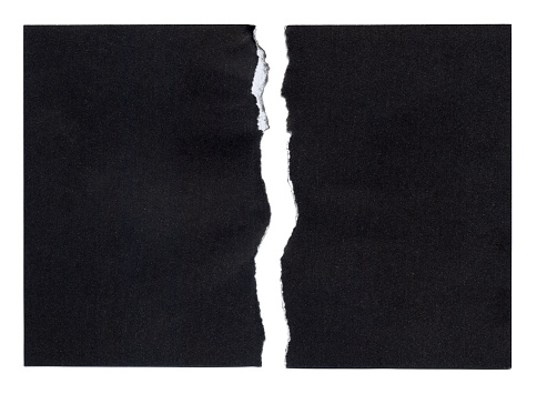 Torn piece of black Paper ready to accept any message.