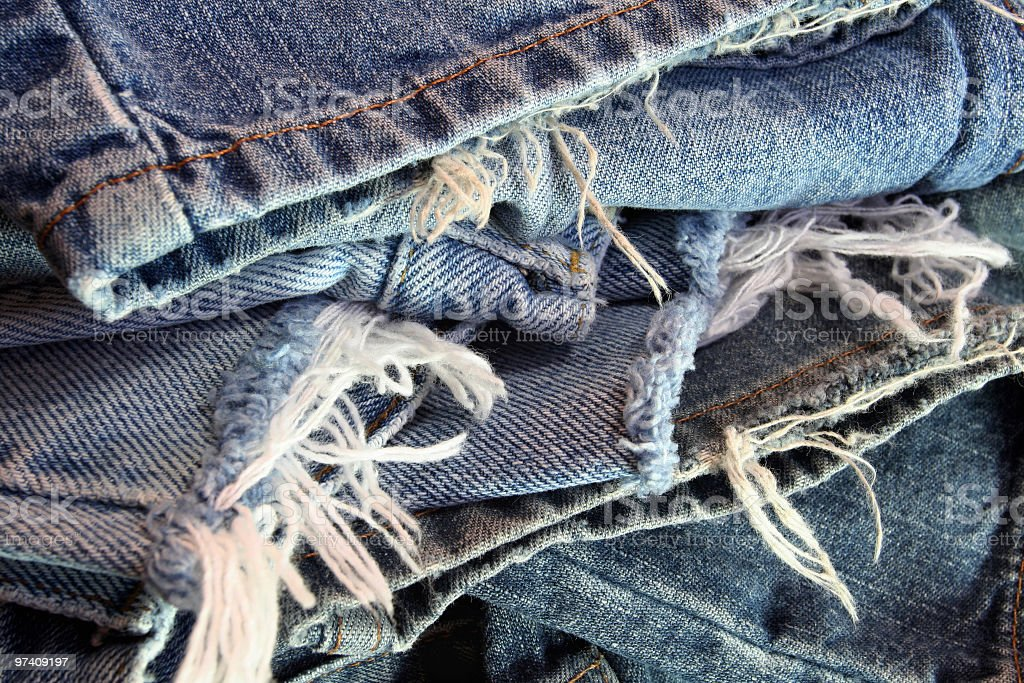 Ragged Old Blue Jeans in a Messy Pile stock photo