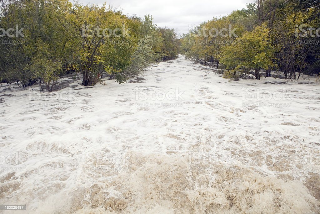 Raging River Floodwater Under a Bridge stock photo