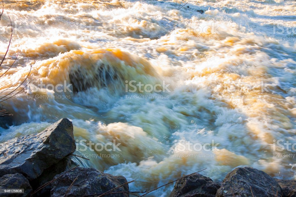 Raging waters and murky - Flooding after several days of torrential rain stock photo