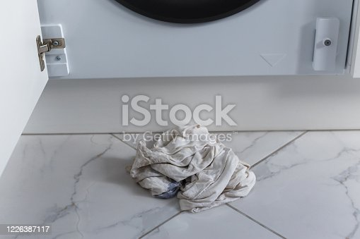 487597124 istock photo Rags for absorbing spilled water leaked from washing machine built into the kitchen furniture 1226387117