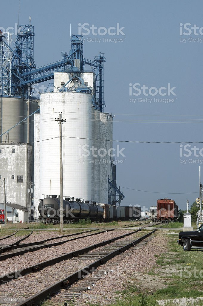 rail cars loading grain at elevator royalty-free stock photo